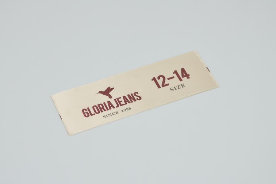 Вшивная этикетка на одежду «Gloria Jeans»